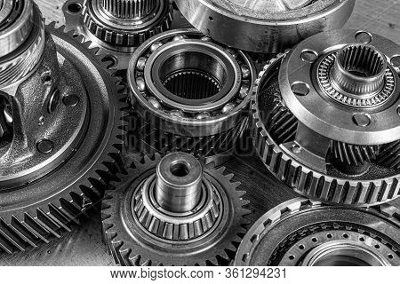 Close-up Of A Car Gearbox. Metallic Shiny Gears For Planetary Gearshift. Industrial Metal Gears For