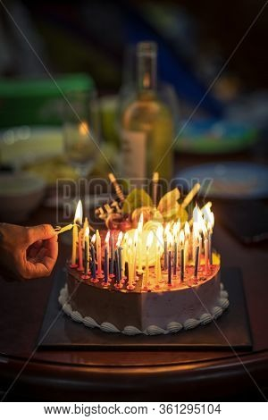 Birthday cake with candles in dark