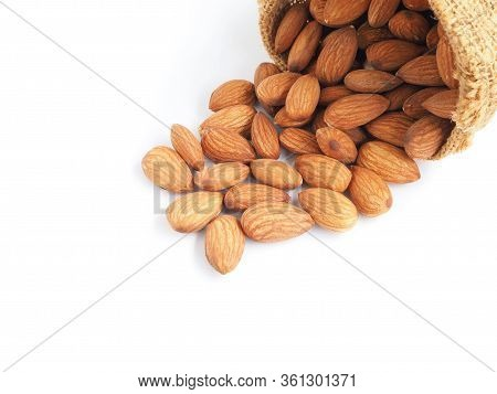 Almonds Seeds In Sackcloth Bag Isolated On A White Background. Healthy Food.