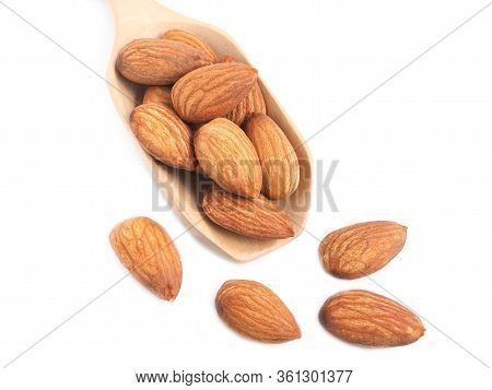 Colse Up Almonds Seed In Wooden Scoop Isolated On A White Backgound. Healthy Food.