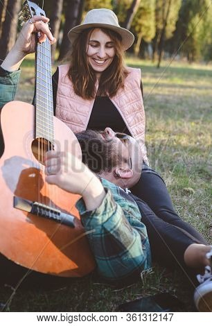 Couple In Love Singing Outdoors. Happy People Lifestyle. Happy Hipster Couple Singing Outdoor. Trave
