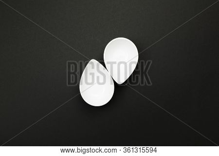 Clean White Tableware On Black Background. Top View