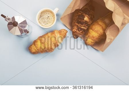 French Breakfast - Espresso And Croissants In Paper Bag On Blue Background. Top View, Copy Space