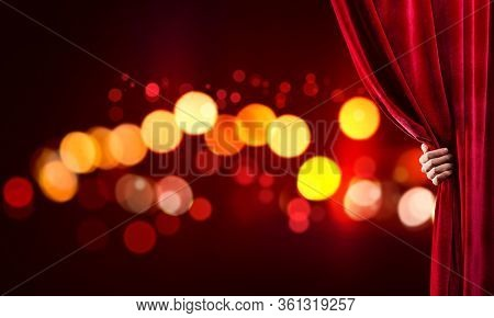 Close Up Of Businessman Hand Open Red Velvet Curtain Of Stage