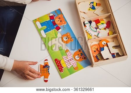 Child Hands With Colorful Board Game On The White Table. Child Playing At The Table. Early Developme