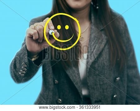 Businesswomen Is Drawing With A Yellow Mark On A Transparent Board, The Hand Is Writing A Happy Smil
