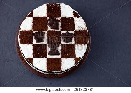 Sponge Cake With Butter Cream. Cake In The Form Of A Chessboard. A Gift For The Day Of A Chess Playe