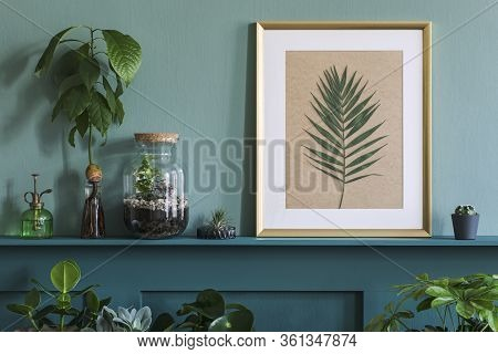 Interior Design Of Living Room With Mock Up Photo Frame On The Green Shelf With Plants In Different
