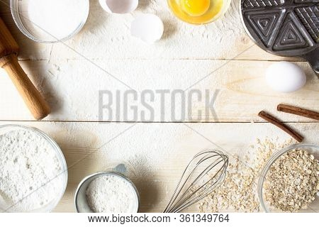 Eggs, Sugar, Flour, Oatmeal, Cinnamon, Whisk, Rolling Pin On Vintage Wooden Background. Cooking Dess
