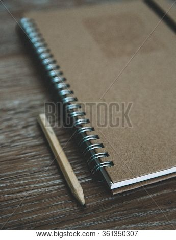 An Old Fashioned Desk Top With A Ring Binder Note Book And Pencil For Taking Notes And Creative Writ
