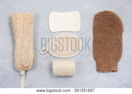 Set Of Eco-friendly Sponges For Body Care On Light Stone Background. Zero Waste Concept For Self-car