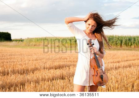 Young Woman With Violin Outdoors