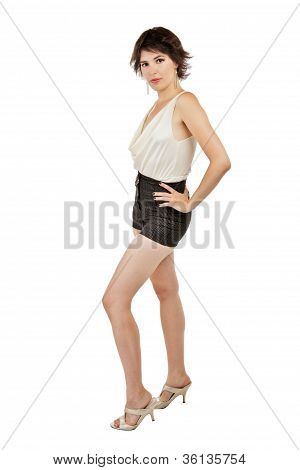 Glamorous Sexy Young Woman Stands Confidently With Hand On Hip.