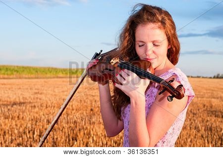 In Love With Music. Woman Kisses The Violin