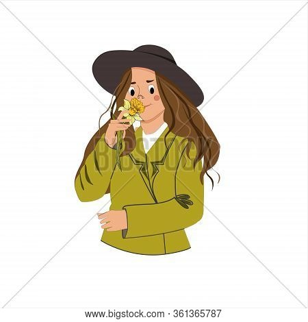 Girl With A Daffodil Flower. Stylish Woman In A Wide-brimmed Hat And A Green Jacket.