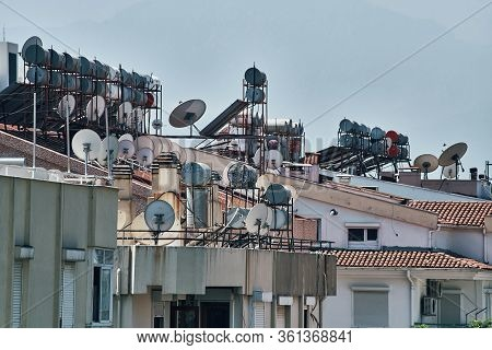 Steel Barrels Of Boilers With Water On The Roof Of A Building To Heat Water. Water Heating By The Su