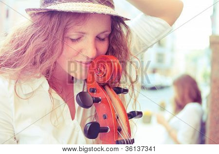 Portrait Of Street Musician Woman With Cello