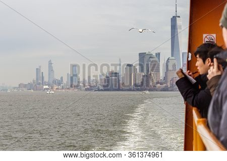 New York, Ny, Usa - March 10, 2020: Travelers Onboard The Staten Island Ferry Take In The View Of Th