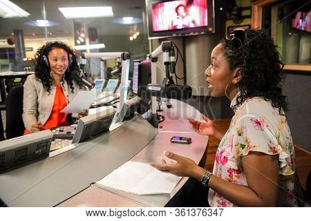 African Female Guests Being Interviewed On Live Talk Radio Show