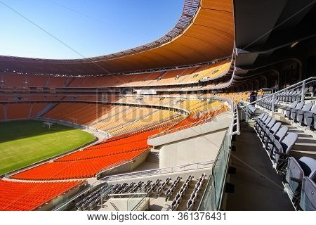 Johannesburg, South Africa - April 15, 2010: Empty Soccer Football Stadium With Orange Seating