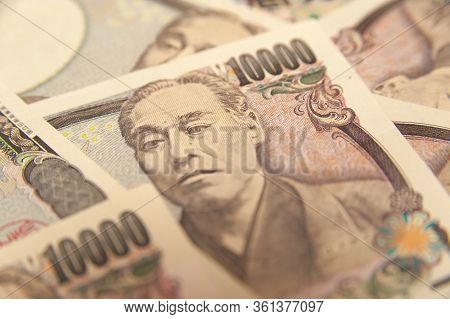 10,000 Yen Note - Close-up On Face On Ten Thousand Yen Banknote (front). Japanese Money. Concept: Fi