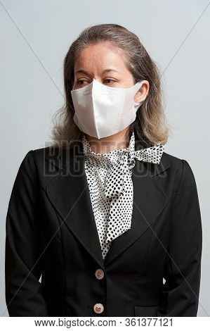 Half Body Portrait Of Middle-aged Mixed Race Woman In Formal Wear Wearing White Disposable 3d Face M