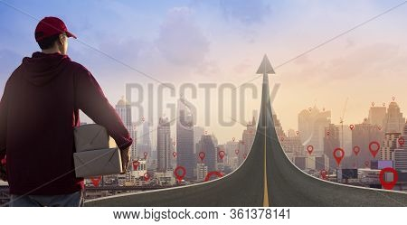 Delivery Man Holding Parcel Boxes On Road Turning Into An Arrow Rising Upward On Map Pin Location.on