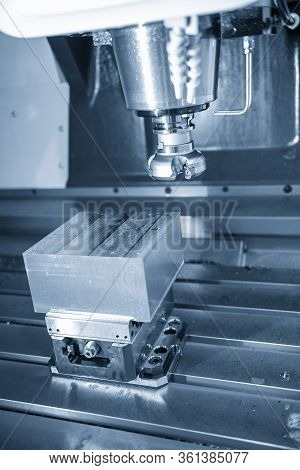 The Vertical Scene Of  Cnc Milling Machine Rough Cutting  The Injection Mold Parts By Face-mill  Too