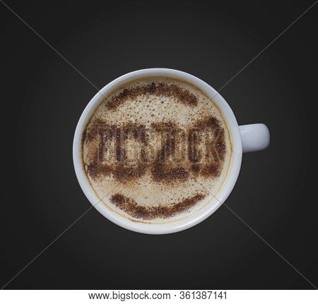 Mug Of Cappuccino With Cinnamon For Breakfast On Dark Background. Cinnamon Powder Is Sprinkled With