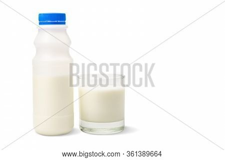 A Plastic Bottle Of Milk And Glass Of Milk Isolated On A White Background With Clipping Path.
