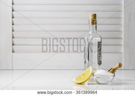 Citric Acid, White Vinegar And A Slice Of Lemon