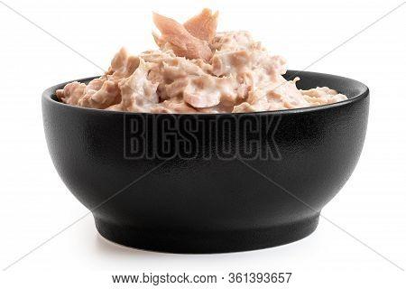 Tuna Mayonnaise With Tuna Flake Garnish In Black Ceramic Bowl Isolated On White. Low Angle.