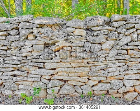 Frontal Shot Of The Detail Of Traditional Drywall As A Fence Of Dirt Road In Promina County In Croat