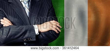 Male Hands Against Irish Flag Background, Business, Politics And Education In Ireland