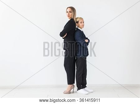 Teenager And Single Parent - Young Mother And Son Standing Together, Back To Back On White Backgroun