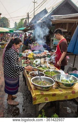 Luang Prabang, Laos - February 26, 2020. Morning Food Market In Unesco Protected Site Of Luang Praba