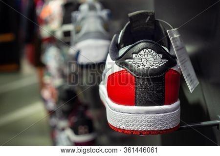 Minsk, Belarus - December 13, 2019: Air Jordan Logo On Sneakers On A Mall Shelf.