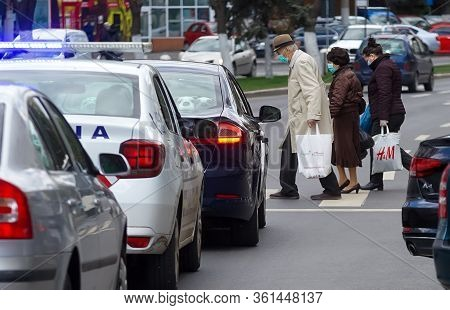 Bucharest, Romania - April 14, 2020: Old People Wearing Mask Are Back From Shopping. Romania Is In L