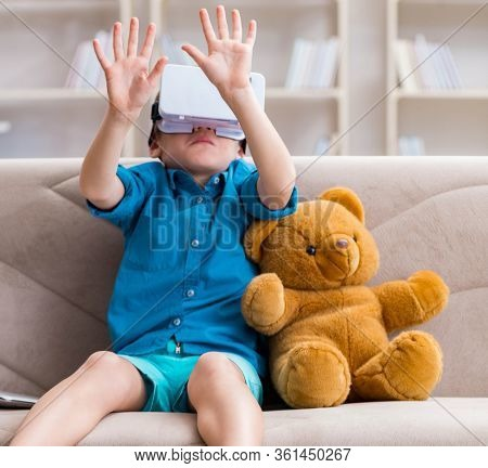 Young little boy with VR virtual reality glasses