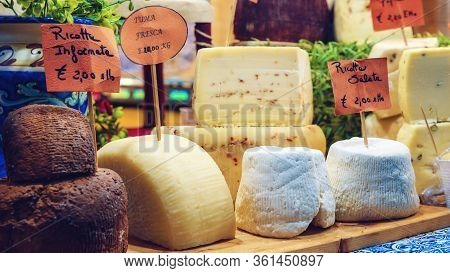 Fresh Toma And Ricotta, Traditional Hard Cheeses On A Market Stall In Piedmont, Italy, With Price Ta