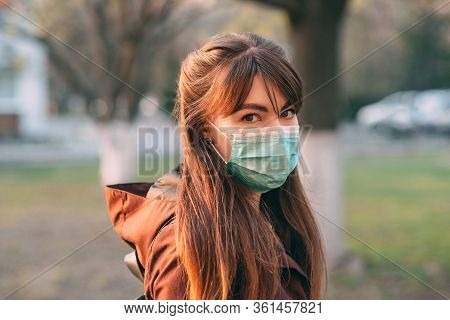 Covid-19 Pandemic Coronavirus Young Girl In City Street Wearing Face Mask Protective For Spreading O