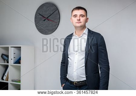 Portrait Of A Caucasian Male Indoors Posing In A Jacket And White Shirt. Overweight Office Worker At