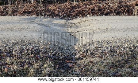 Gravel Road, Frost Heave And Dip At Center Line Culvert