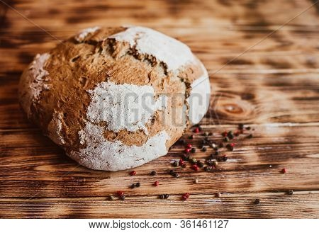 Grain Artisan Bread Loaf. Rustic Loaf Of Homemade Bread Son Dark Wooden Table. Homemade Loaf Of Brea