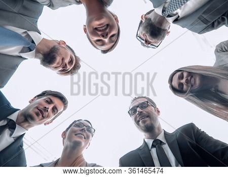 bottom view.a group of employees stands forming a circl