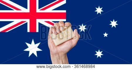 Caucasian Male Hand Holding A Bar Of Soap With Words: Wash Your Hands Against An Australian Flag Bac