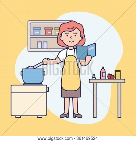 Cooking Concept. Happy Girl Is Cooking Food At Kitchen. Woman Is Reading The Recipe, Cooking And Hav