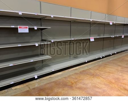 Supermarket Shelves Displaying An Absence Of Goods For Sale