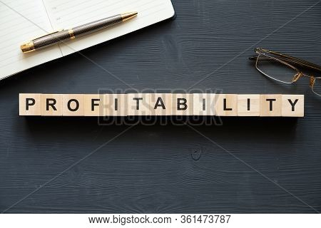 Modern Business Buzzword - Profitability. Top View On Wooden Table With Blocks. Top View. Close Up.