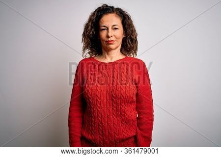 Middle age brunette woman wearing casual sweater standing over isolated white background looking sleepy and tired, exhausted for fatigue and hangover, lazy eyes in the morning.